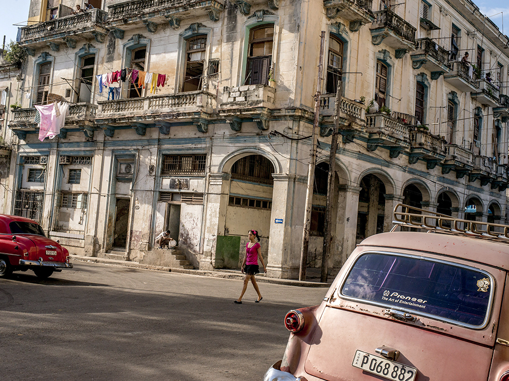 A street in Havana, with its dilapidated but architecturally rich buildings, and vintage American cars.
